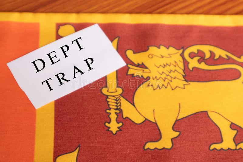 Concept of Dept trap printed on paper, Sri lankan flag as a background.  stock image