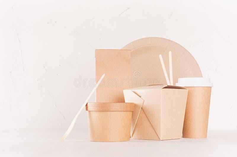 Concept design brown paper pack for go food for restaurant, cafe, shop, advertising - bowl, noodles box, cup, packet, plate. Concept design brown paper pack for royalty free stock images