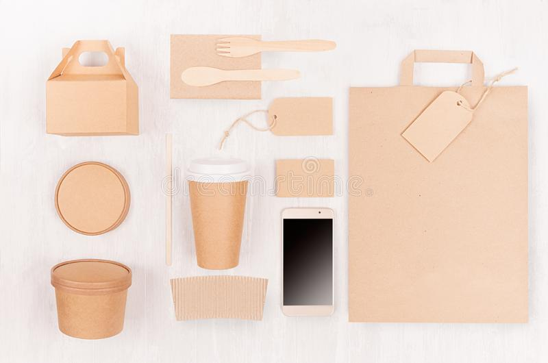 Concept design disposable brown paper pack for go food for restaurant, cafe, shop, advertising - bag, coffee cup, box for soup. royalty free stock photos