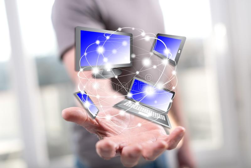 Concept of devices connection. Devices connection concept above the hand of a man in background royalty free stock photography