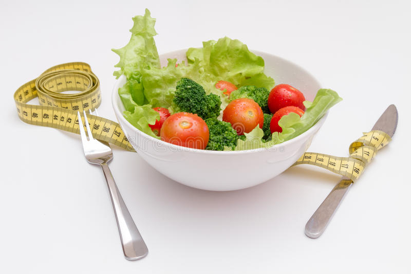 Concept diet fresh vegetables on plate at white background.  stock image