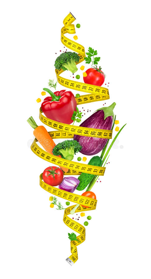 Concept of diet. Measuring tape spiral twists vegetables stock images