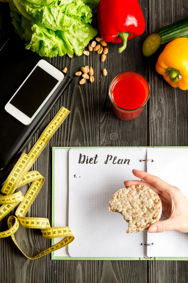 Concept diet, slimming plan with vegetables top view mock up. Concept diet and slimming plan with vegetables top view mock up on wooden background royalty free stock image