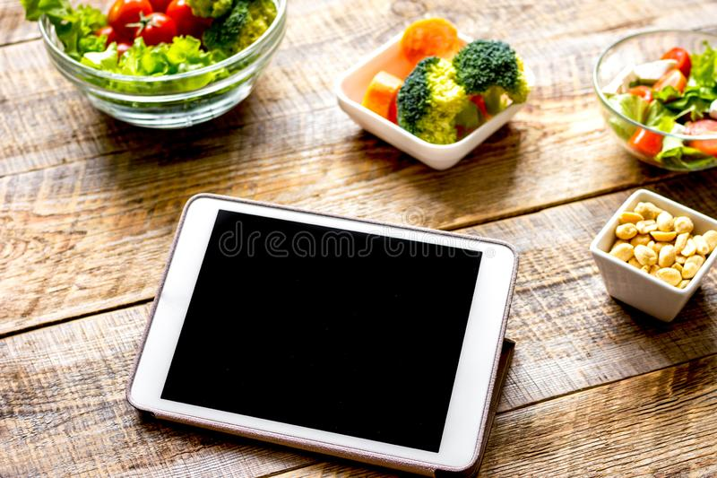 Concept diet and tablet with vegetables mock up stock photos