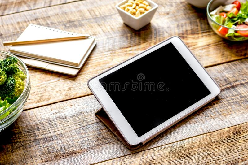 Concept diet and tablet with vegetables mock up royalty free stock images