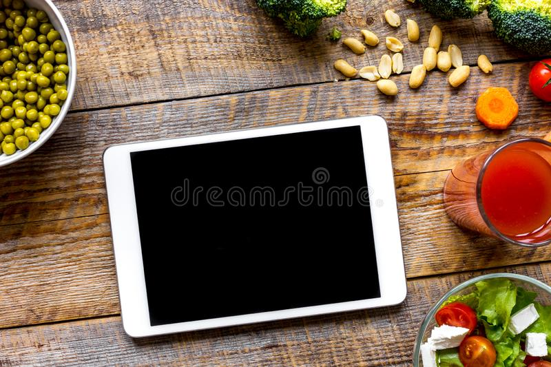Concept diet and tablet with vegetables mock up stock image