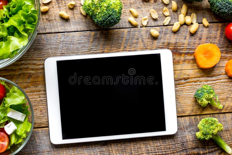 Concept diet and tablet with vegetables mock up stock photography