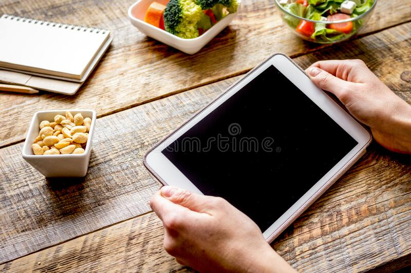 Concept diet and tablet with vegetables mock up royalty free stock photos