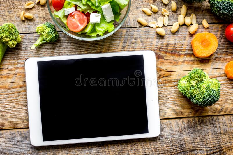 Concept diet and tablet with vegetables mock up royalty free stock photography