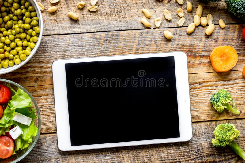 Concept diet and tablet with vegetables mock up royalty free stock image