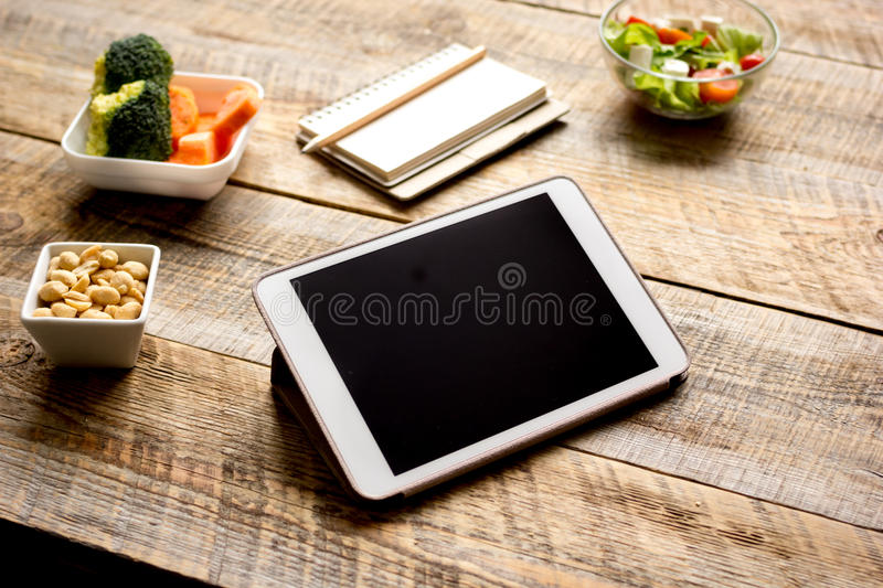Concept diet and tablet with vegetables mock up. On wooden background stock images