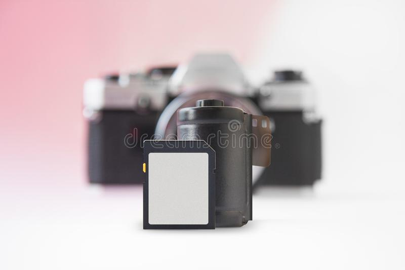 Concept - Digital Photography vs. Film Photography with Blurry Camera on Back stock photo