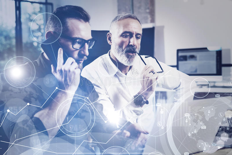 Concept of digital screen,virtual connection icon,diagram, graph interfaces.Bearded young man using mobile phone and. Concept of digital screen,virtual stock images