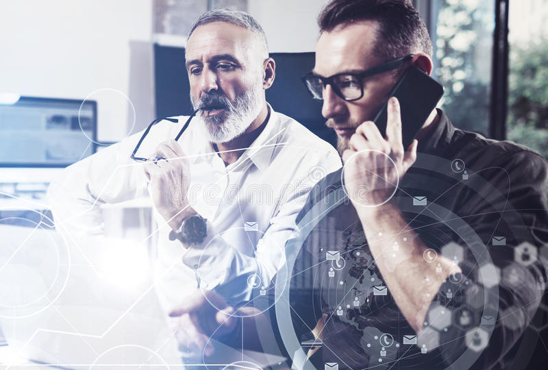 Concept of digital screen,virtual connection icon,diagram, graph interfaces.Bearded young man using mobile phone and. Concept of digital screen,virtual stock photo