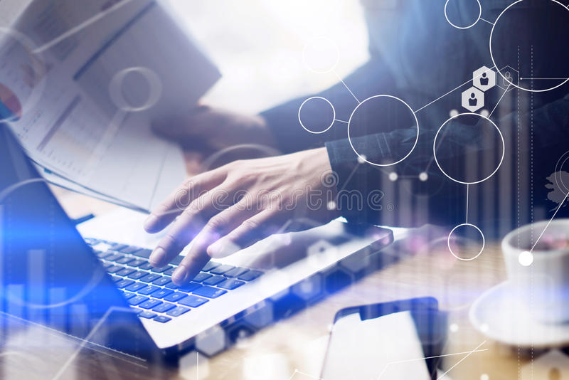 Concept of digital screen,virtual connection icon,diagram,graph interfaces.Businessman working at sunny office on laptop royalty free stock photography