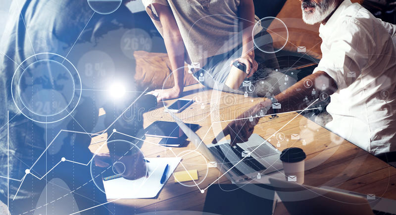 Concept of digital screen ,virtual connection icon,diagram, graph interfaces.Team young coworkers making great work. Discussion in modern office.Business stock photography