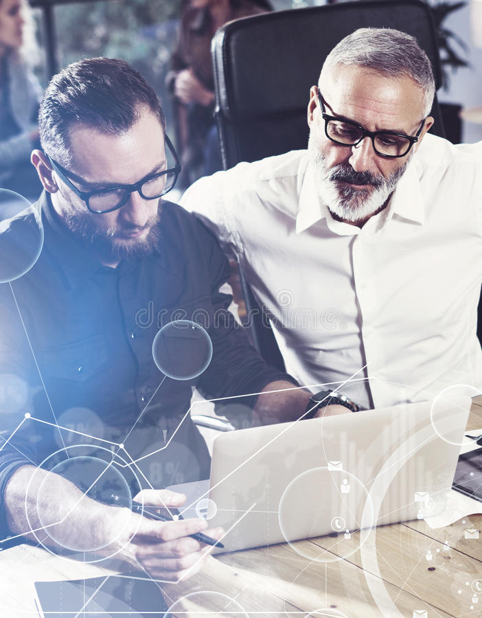 Concept of digital screen,virtual connection icon,diagram, graph interfaces.Young bearded man working together with. Concept of digital screen,virtual connection royalty free stock photo