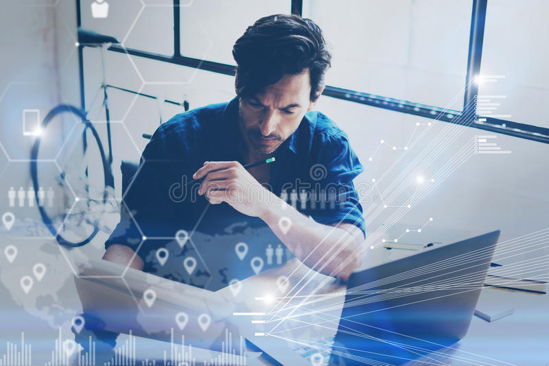 Concept of digital screen,virtual connection icon,diagram,graph interfaces.Young coworker working at coworking place on. Modern laptop.Businessman analyze stock royalty free stock images