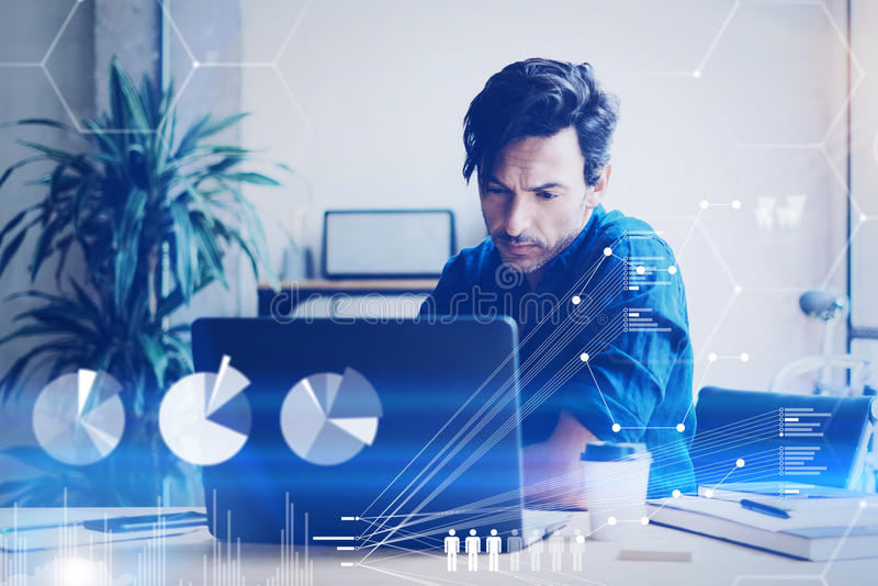 Concept of digital screen,virtual connection icon,diagram,graph interfaces.Young coworker working at office on laptop. Businessman analyze stock reports.Blurred royalty free stock photo