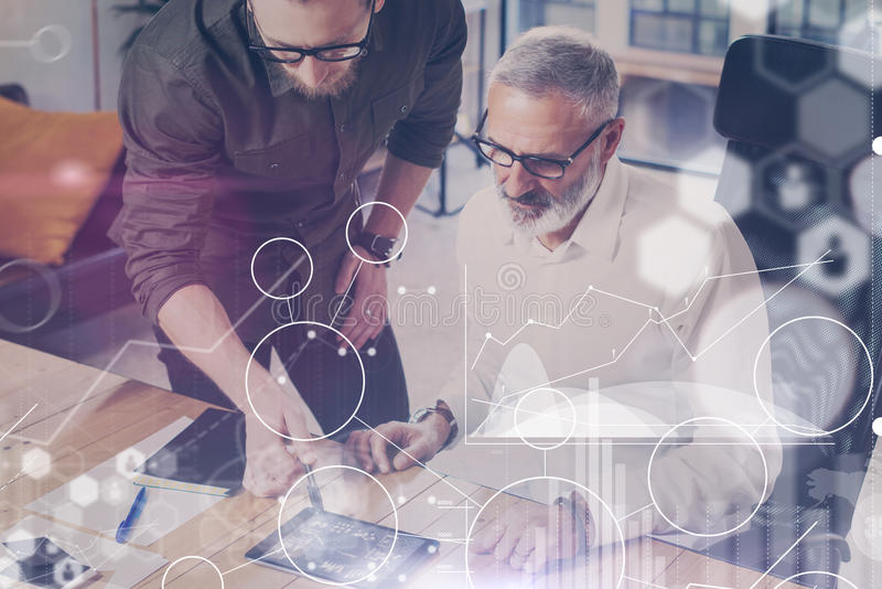 Concept of digital screen,virtual connection icon,diagram, graph interfaces.Young team coworkers found a great work. Solution in modern coworking studio.Bearded royalty free stock photos