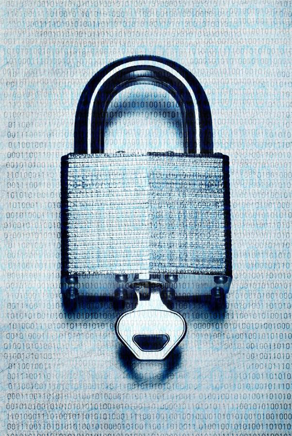 Digital security and encryption with binary code overlaid on steel padlock and key. Concept digital security and encryption with binary code overlaid on steel royalty free stock photo