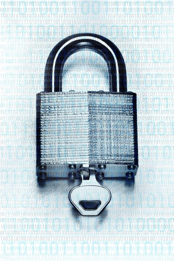 Binary code overlaid on steel padlock and key. Concept digital security and encryption with binary code overlaid on steel padlock and key on scratched steel royalty free stock photography