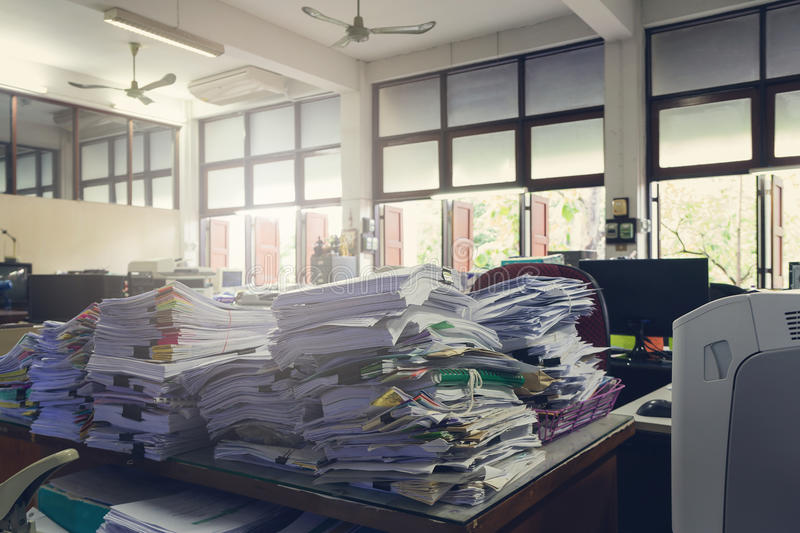 Concept of document workload, Pile of unfinished documents on office desk, Stack of business paper. Vintage effect stock images