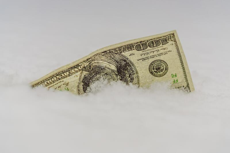 The concept of the dollar frozen at one point, 100 dollars froze stock photo