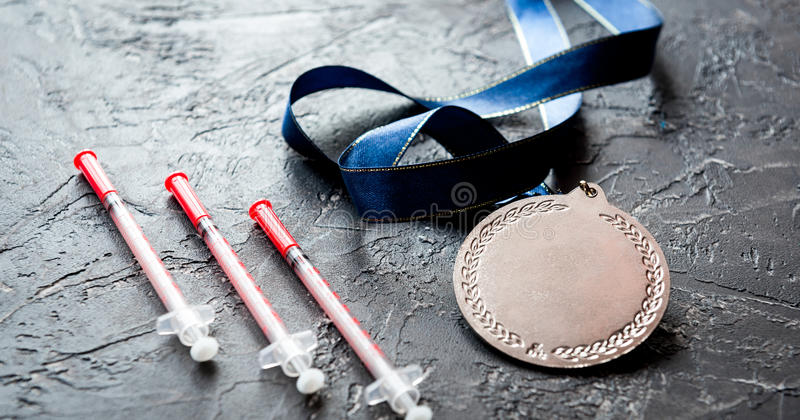 Concept of doping in sport - deprivation medals. Close up on dark background royalty free stock photography