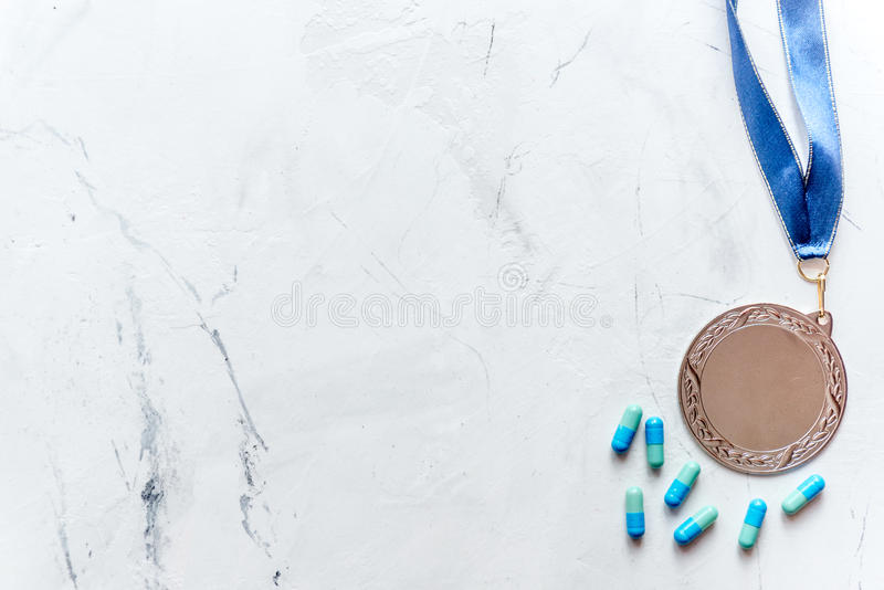 Concept of doping in sport - deprivation medals top view.  royalty free stock photo