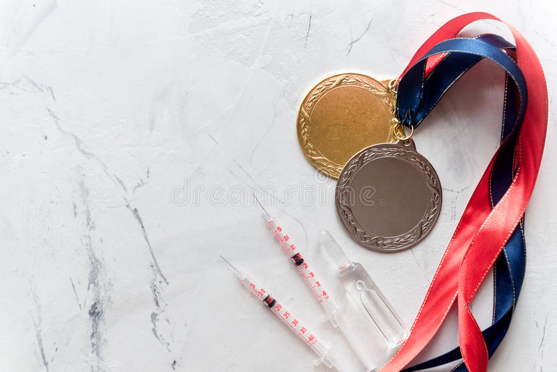 Concept of doping in sport - deprivation medals top view.  stock images