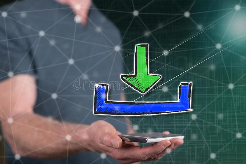 Concept of download. Download concept above a smartphone held by a man in background royalty free stock photos