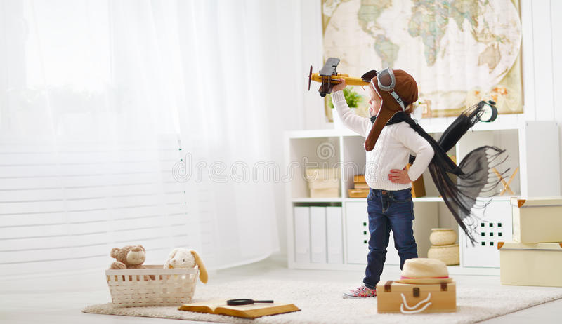 Concept of dreams and travels. pilot aviator child with a toy a royalty free stock images
