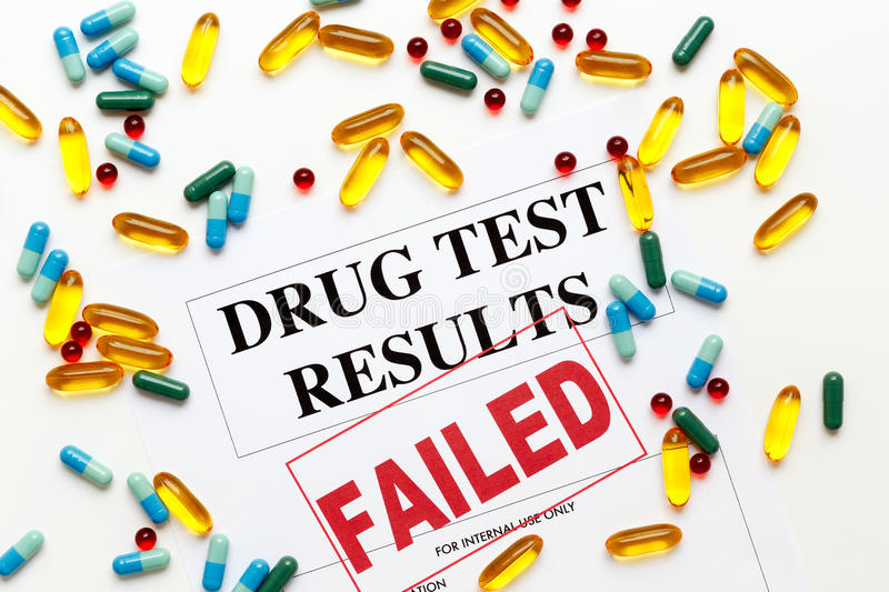 Concept drug test results are failed with pills. Concept drug test results are failed on white background with pills stock photo