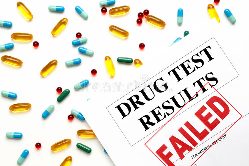 Concept drug test results are failed with pills. Concept drug test results are failed on white background with pills royalty free stock photo