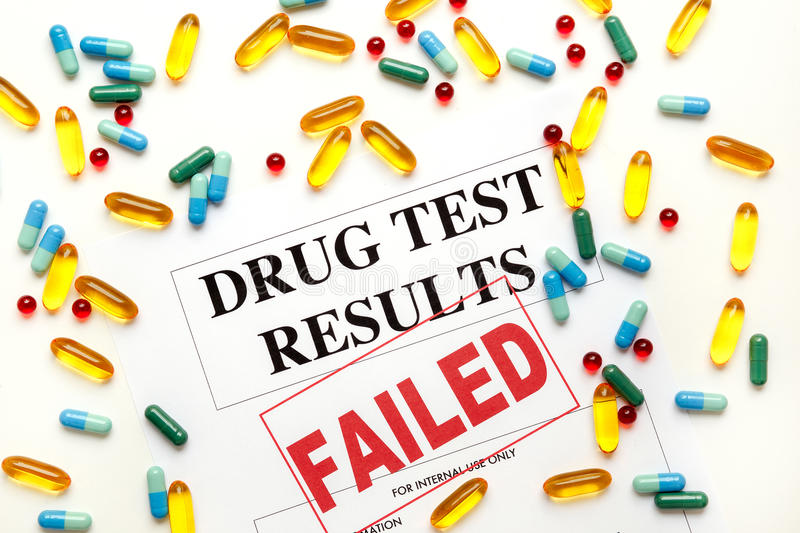 Concept drug test results are failed with pills. Concept drug test results are failed on white background with pills stock photos