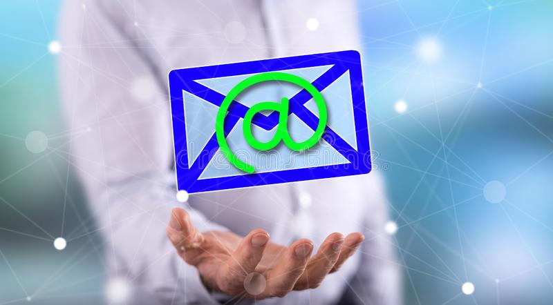 Concept of e-mail. E-mail concept above the hand of a man in background royalty free stock photo