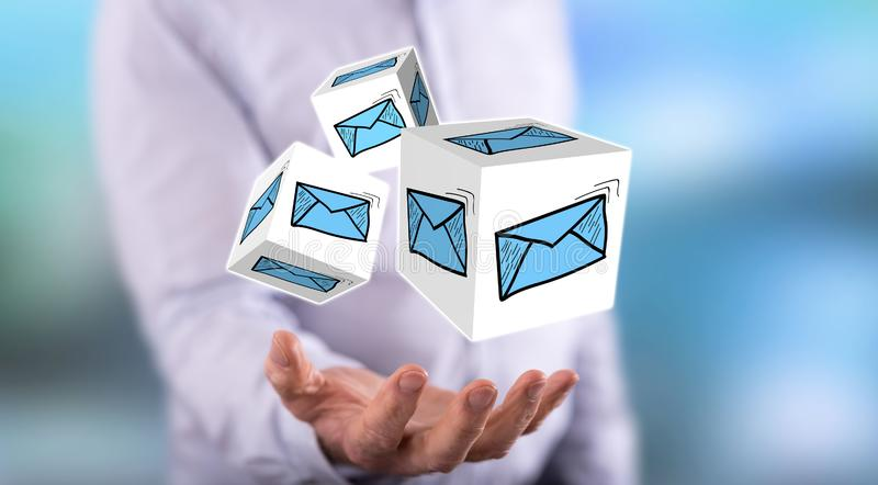 Concept of e-mail. E-mail concept above the hand of a man in background stock photos