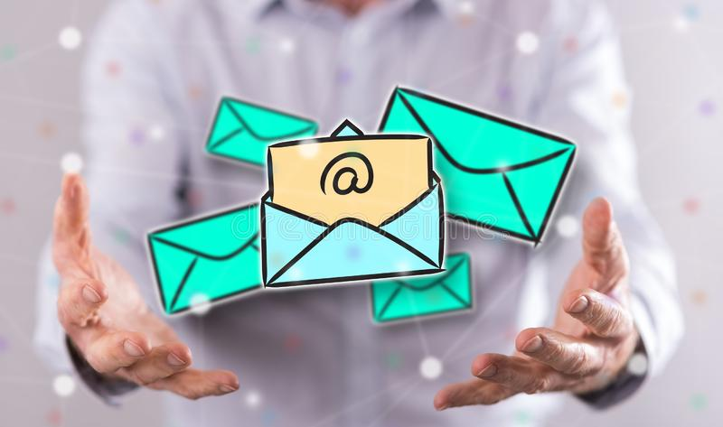 Concept of e-mail. E-mail concept above the hands of a man in background royalty free stock photography