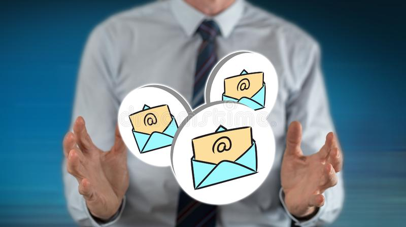 Concept of e-mail. E-mail concept between hands of a man in background royalty free stock photos
