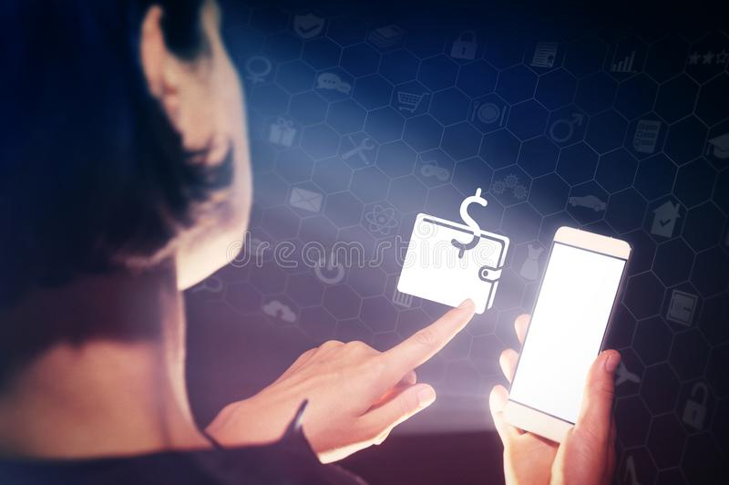 Concept of e-wallet, online banking and electronic financial transactions. Image of a girl with a smartphone in hands. She presses on the purse icon.Concept of stock photography