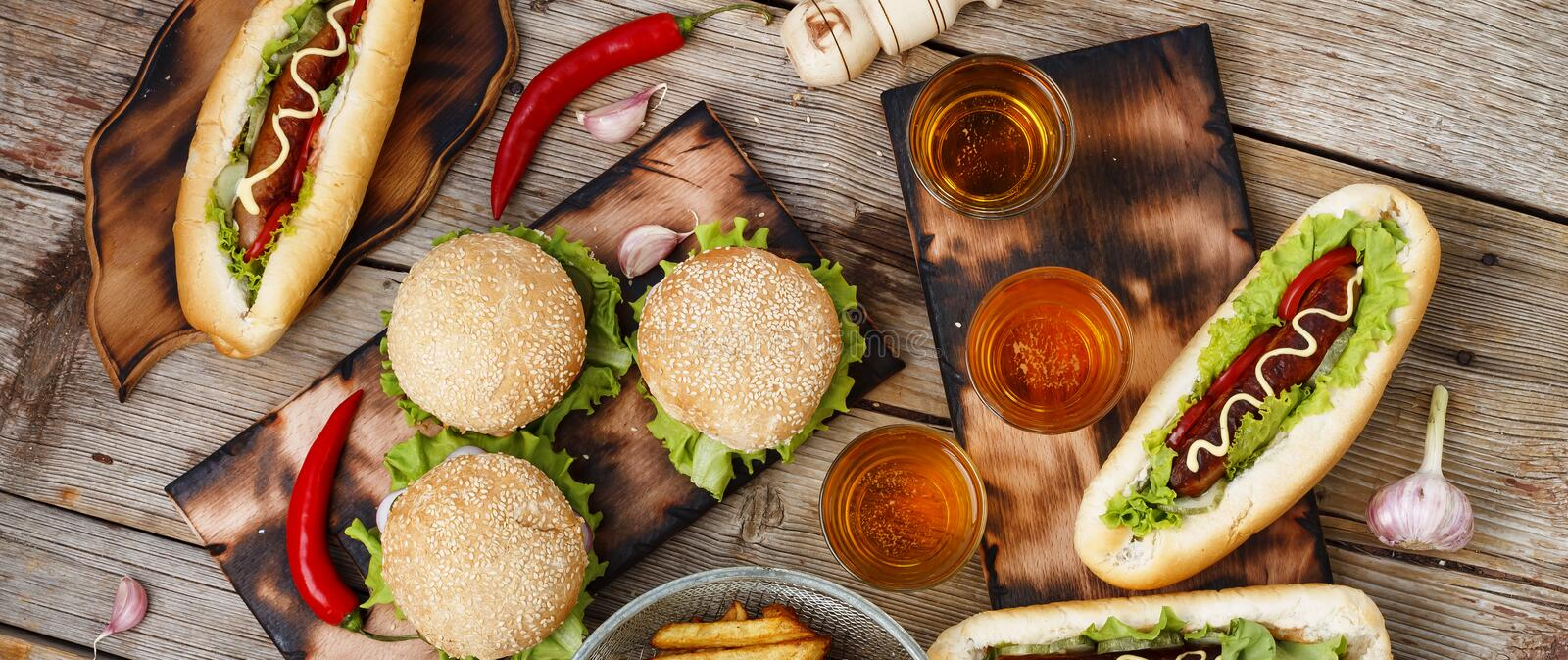 Festival of beer. Hot dogs, hamburgers, barbecue. Concept of eating outdoors. Concept of eating outdoors. Festival of beer. Hot dogs, hamburgers, barbecue stock image