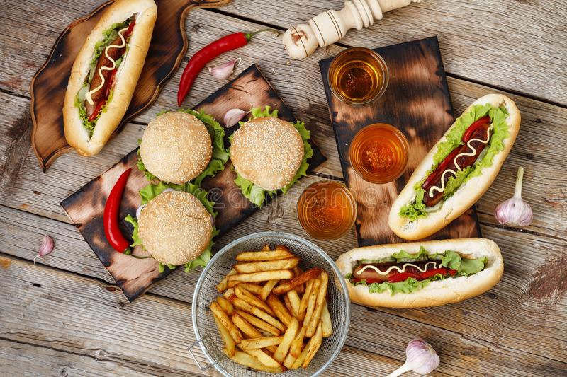 Festival of beer. Hot dogs, hamburgers, barbecue. Concept of eating outdoors. Concept of eating outdoors. Festival of beer. Hot dogs, hamburgers, barbecue royalty free stock images
