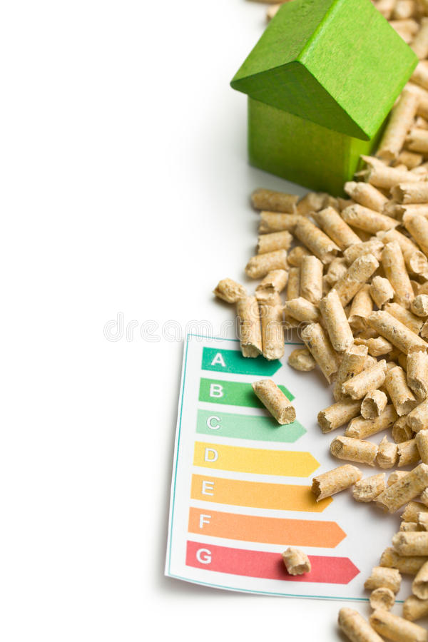 Concept of ecological and economic heating. Wooden pellets. royalty free stock images