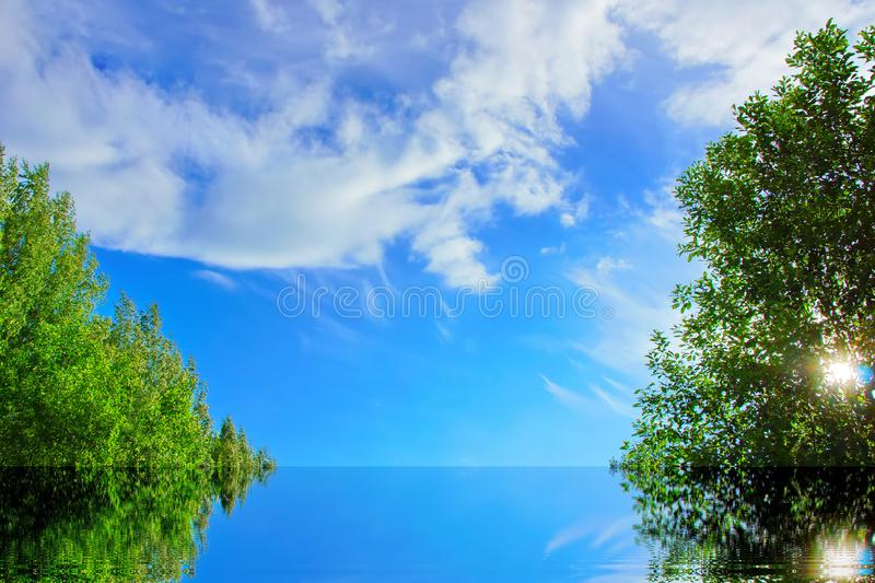 Concept of ecology, blue sky clouds water, trees green royalty free stock photography