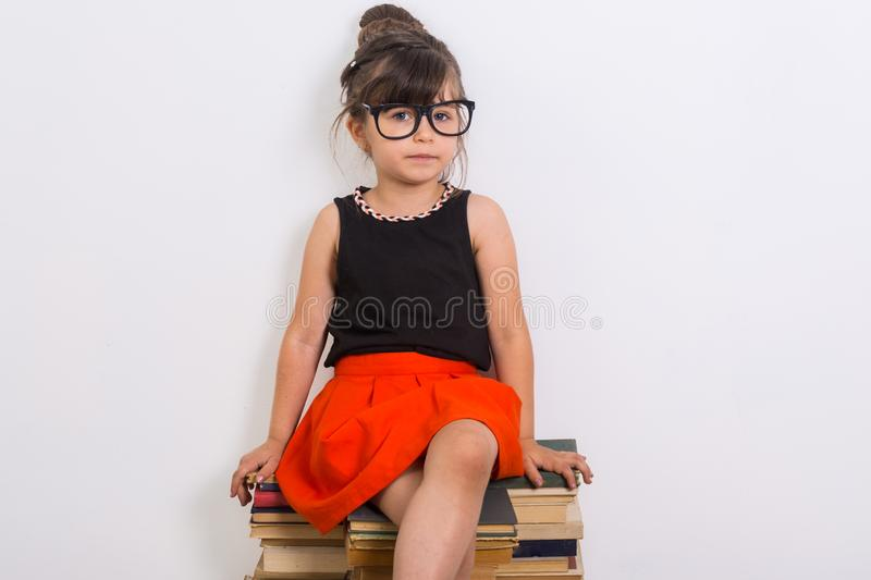 Concept of education and reading. Industrious child. Little Girl reading the book. stock photo