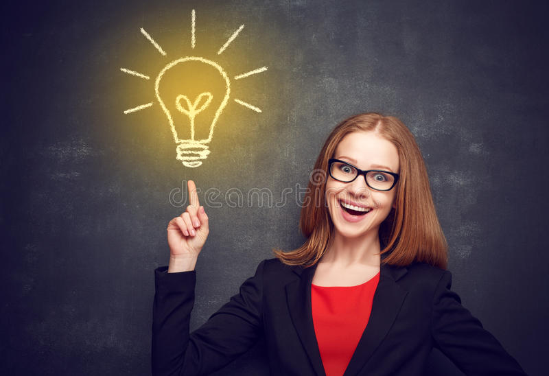 Concept of education. woman in glasses at blackboard visited i. Concept of education. woman in glasses at the blackboard visited the idea royalty free stock images