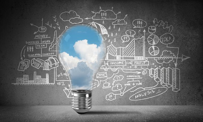 Concept of effective marketing innovations. Lightbulb with cloudly skyscape inside placed against sketched business-analytical information on wall. 3D rendering stock illustration