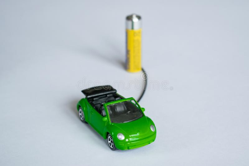 Concept of electric car. model car charge from battery. save planet. gas polution. Car model on white background stock images