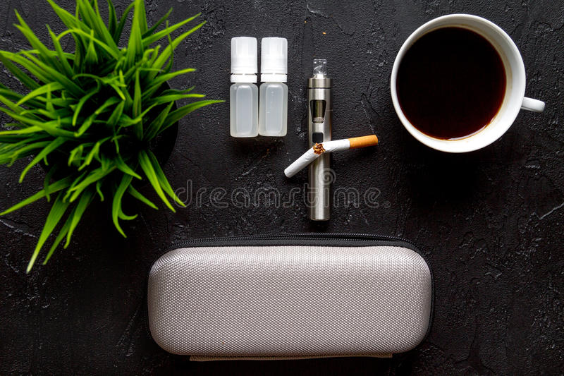 Concept of electronic cigarette on dark background top view.  royalty free stock photography